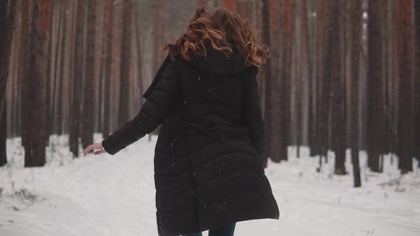 Thumbnail for Portrait of a Red-haired Girl with an Elven Appearance in a Winter Forest. Girl Runs Through the