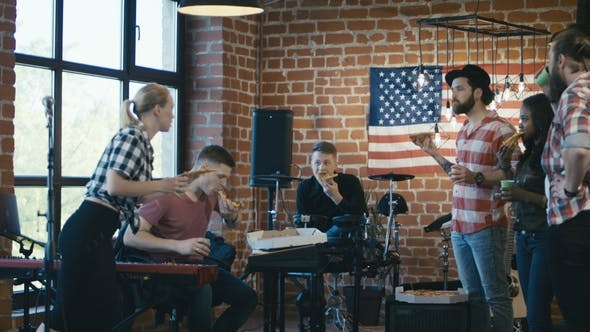 Thumbnail for Musicians Having Pizza During Rehearsal