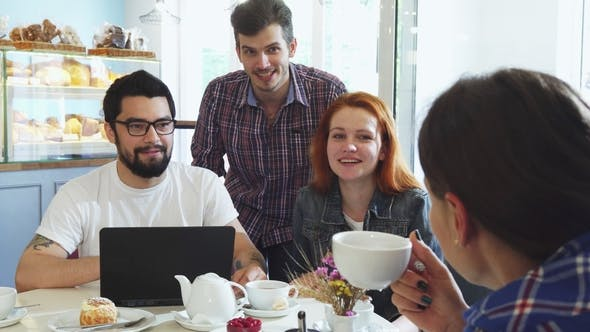 Thumbnail for Happy Young Friends Laughing, Enjoying Having Coffee Together