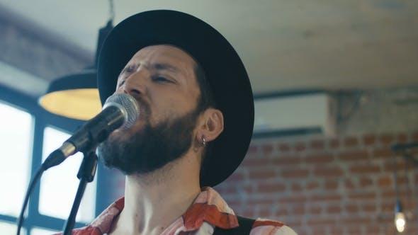 Thumbnail for Singing Guitarist in Hat
