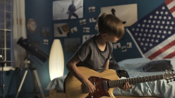 Thumbnail for Youngster with Guitar in Bedroom