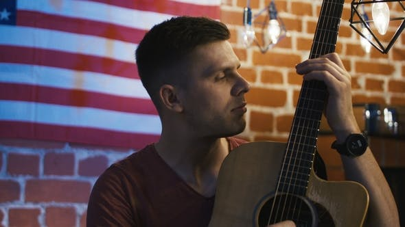 Thumbnail for Handsome Young Guitarist Looking at Camera