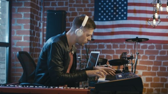 Thumbnail for Keyboardist Recording Music with Laptop