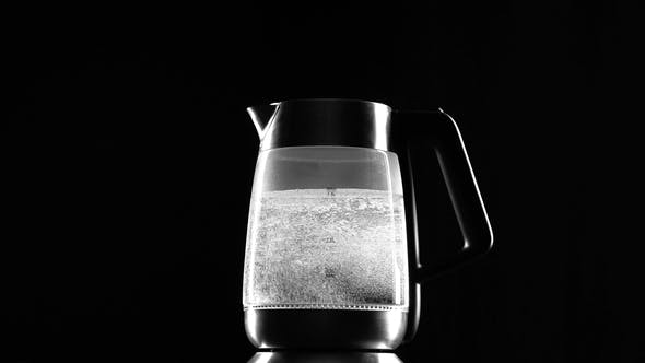 Thumbnail for Electric Kettle Begins To Boil on Black Background