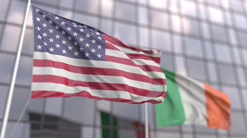 Waving Flags of the USA and Ireland in Front of a Building