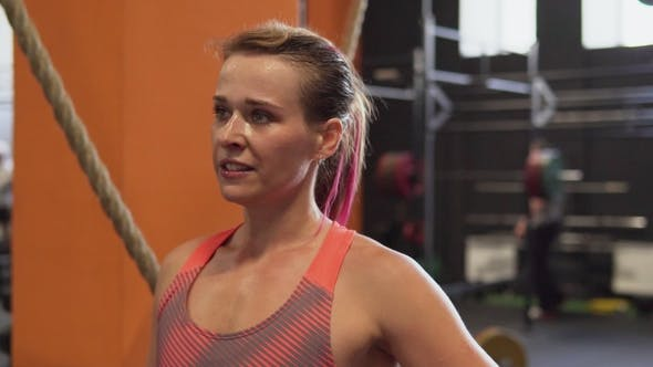 Thumbnail for Face of Tired and Satisfied Fitness Woman After Workout in Gym