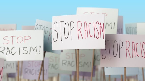 STOP RACISM Placards at Street Demonstration