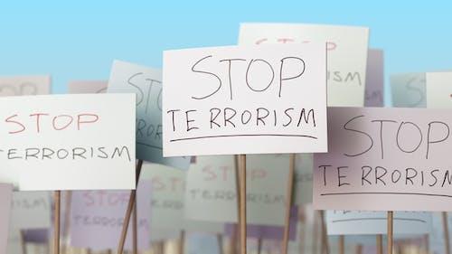 STOP TERRORISM Placards at Street Demonstration