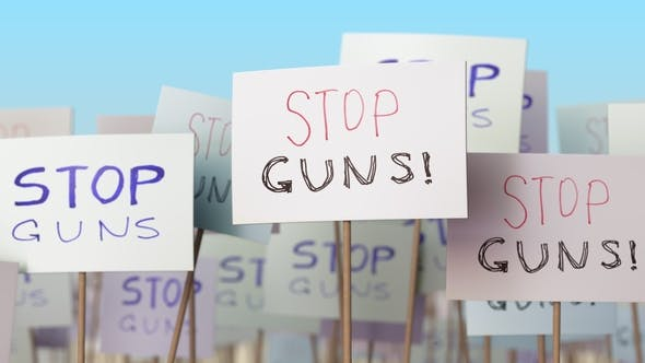 Thumbnail for STOP GUNS Placards at Street Demonstration
