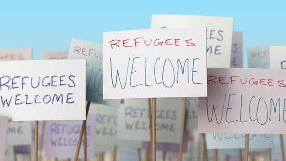 REFUGEES WELCOME Placards at Street Demonstration