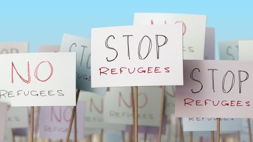 STOP REFUGEES Placards at Street Demonstration