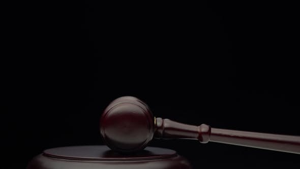 Thumbnail for Wooden Judge's Hammer on the Stand Black Background