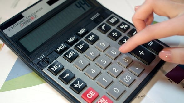 Woman Using Calculator. Business Accounting and Money Calculation
