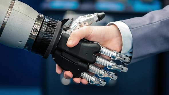 Thumbnail for Hand of a Businessman Shaking Hands with a Android Robot.
