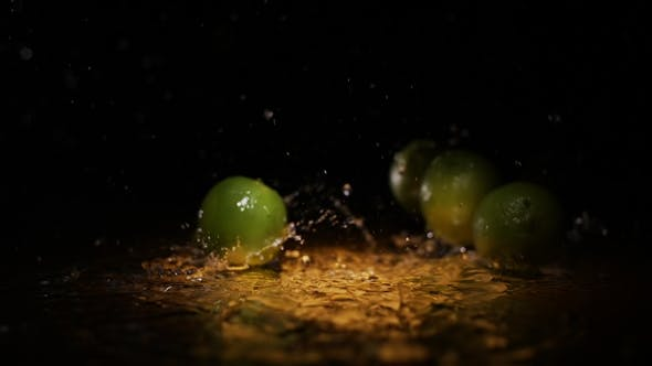 Thumbnail for Fresh Citrus Fruits Lime Falling on Water Surface in Light Spot with Liquid Splash and Droplets