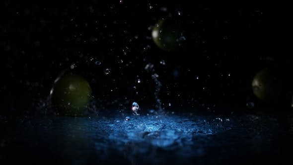 Thumbnail for Fresh Limes Falling on Water Surface in Blue Light Spot with Liquid Splash and Drops in