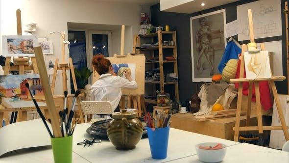Thumbnail for Ginger Female Artist Painting Still Life in Art Studio