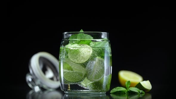 Cover Image for Soda Lemonade with Lime Lemon and Mint in Cold Sparkling Water. Fresh Non Alcoholic Mojito Cocktail