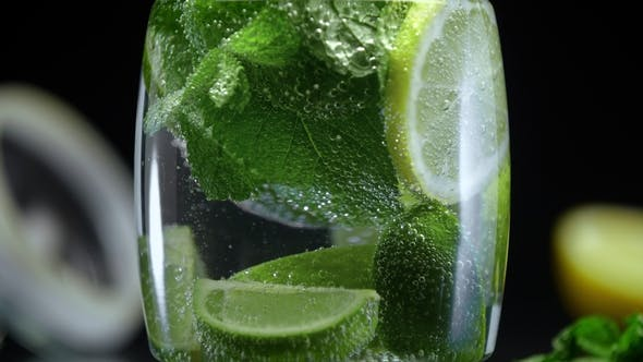 Cover Image for Lemonade with Lime Lemon and Mint in Cold Sparkling Water Soda Prepared for Summer Party