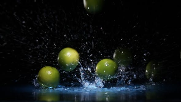 Thumbnail for Lime Citrus Fruits Falling on Water Surface in Blue Light Spot with Liquid Splash and Drops