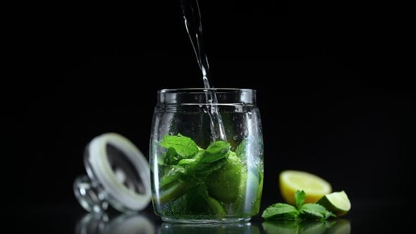 Cover Image for Non Alcoholic Mojito Lemonade with Lime Lemon and Mint in Cold Sparkling Soda Water