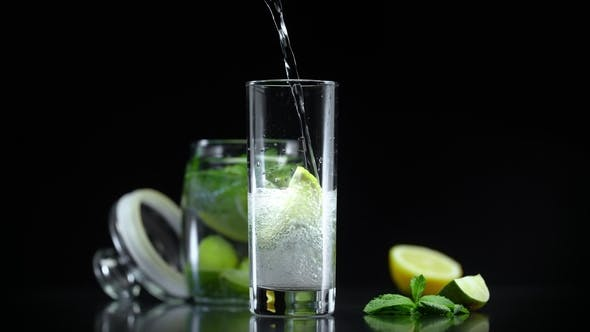 Cover Image for Lemonade with Lime Lemon Mint in Cold Sparkling Soda Water. Refreshing Non Alcoholic Mojito Cocktail