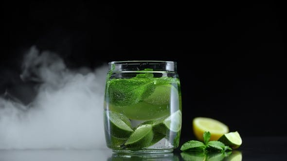 Thumbnail for Lemonade Lime Lemon Mint in Sparkling Water. Fresh Non Alcoholic Mojito in Cold Cloud Fog for Party