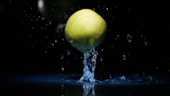 Thumbnail for Limes Falling on Water Surface in Blue Light Spot with Liquid Splash and Drops