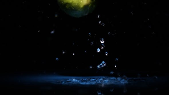 Thumbnail for Fresh Lime Fruits Falling on Water Surface in Blue Light Spot with Liquid Splash and Drops