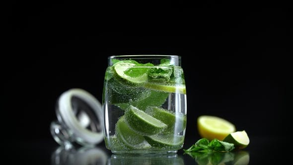 Cover Image for Mojito Citrus Lemonade Lime Lemon Mint in Cold Sparkling Soda Water Prepared for Drinking