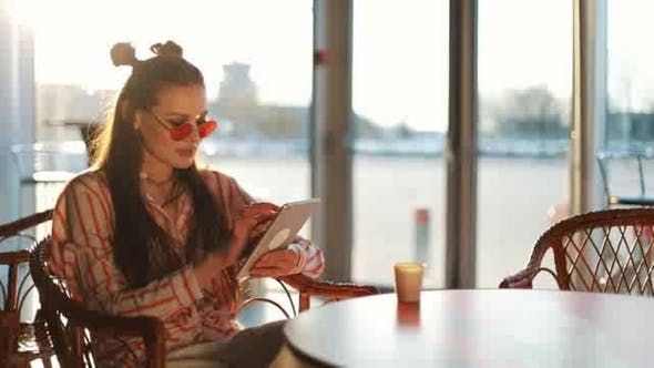Thumbnail for Young Attractive Woman in Red Sunglasses with Tablet Computer Sitting in Cafe Beautiful Girl in