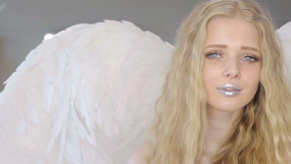 Thumbnail for Young Blond Woman Posing at Camera
