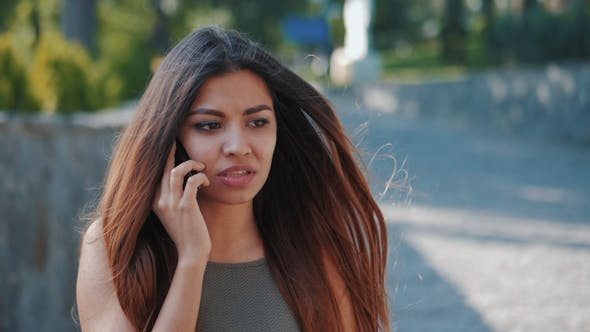Thumbnail for Indignant and Dissatisfied Girl Speaks on the Phone