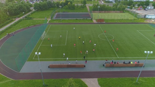 Thumbnail for Green Soccer Field. Players Playing Football. Aerial View. Flying Sideways