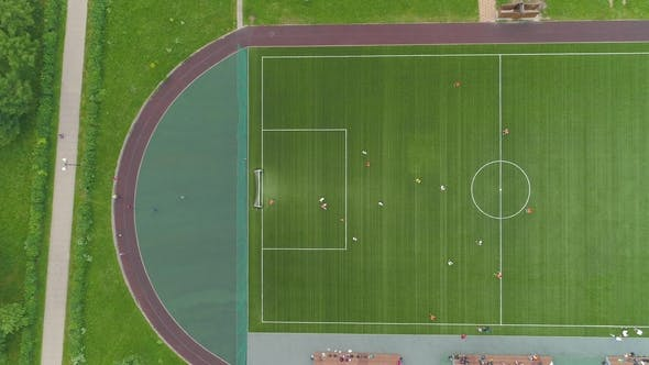 Thumbnail for Green Soccer Field Players Playing Football Aerial Vertical Top-Down View Flying Sideways