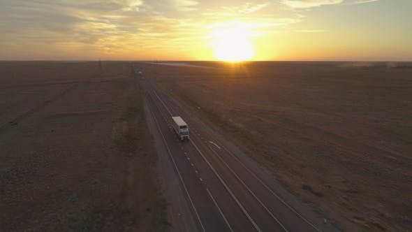 Thumbnail for Truck Is Going on Highway in the Sunny Summer Evening. Aerial View