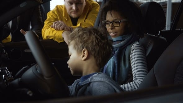 Thumbnail for Diverse Family Testing New Car in Salon