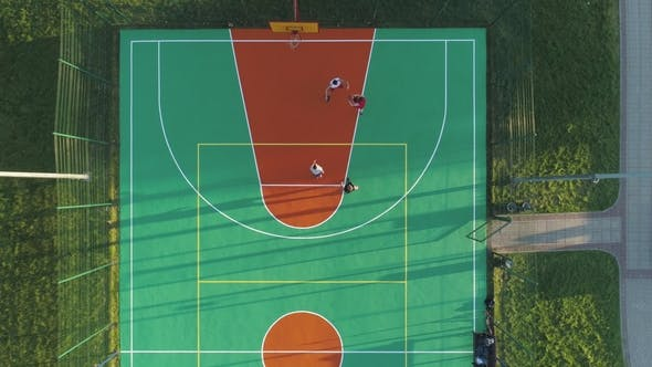 Thumbnail for People Are Playing Basketball on Playground in Urban Park
