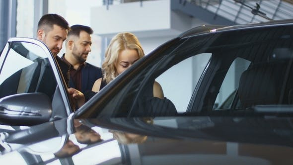 Thumbnail for Family Taking Seats in New Car in Salon