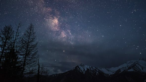 Thumbnail for Milky Way Galaxy Stars Over Snow Capped Mountains at a Clear Night
