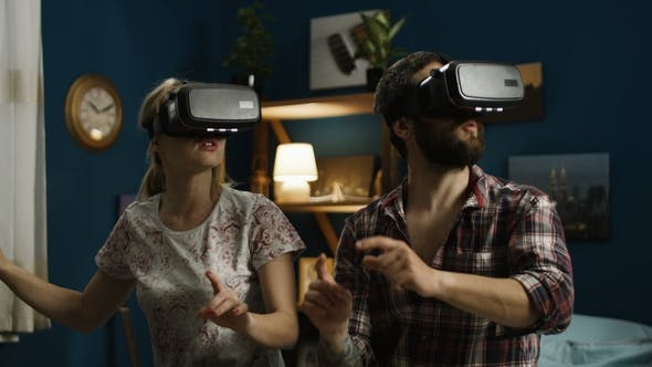 Thumbnail for Couple in VR Glasses Having Fun on Bed