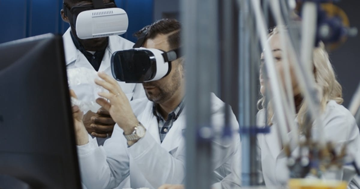 Scientists Working with 3d Printing and VR