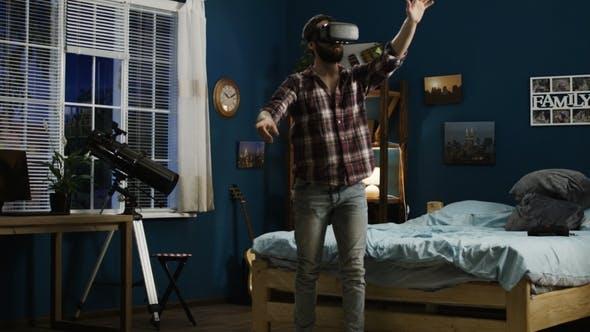 Man Exploring Virtual Reality in Goggles