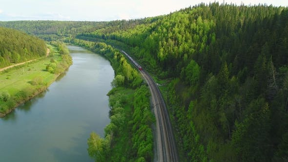 Thumbnail for Flying Back Over Passing Train. River and Green Forest. Aerial View