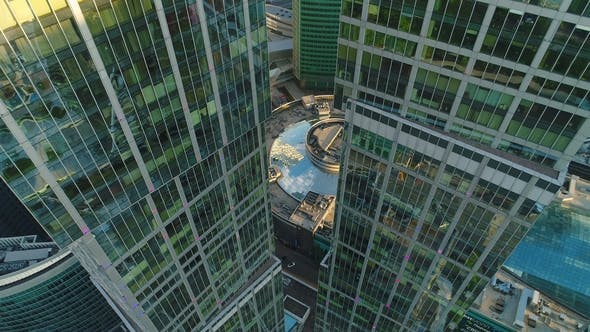 Thumbnail for Flying Up Between Two Modern Tall Skyscrapers with Offices and Apartments in Morning. Aerial View