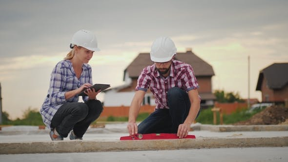Engineers Check the Accuracy of Building Construction. Use the Level and the Tablet