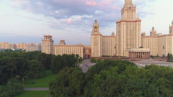 Cover Image for Moscow State University in Summer. Russia. Flying From Trees To Panoramic View. Aerial View