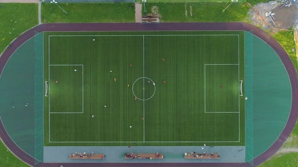 Thumbnail for Green Soccer Field. Players Playing Football. Aerial Vertical Top-Down View