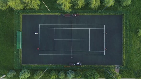 Cover Image for Players Play Tennis on a Green Court