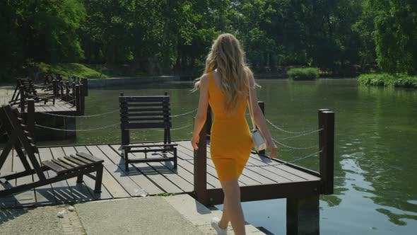 Thumbnail for Woman walking on a wooden dock